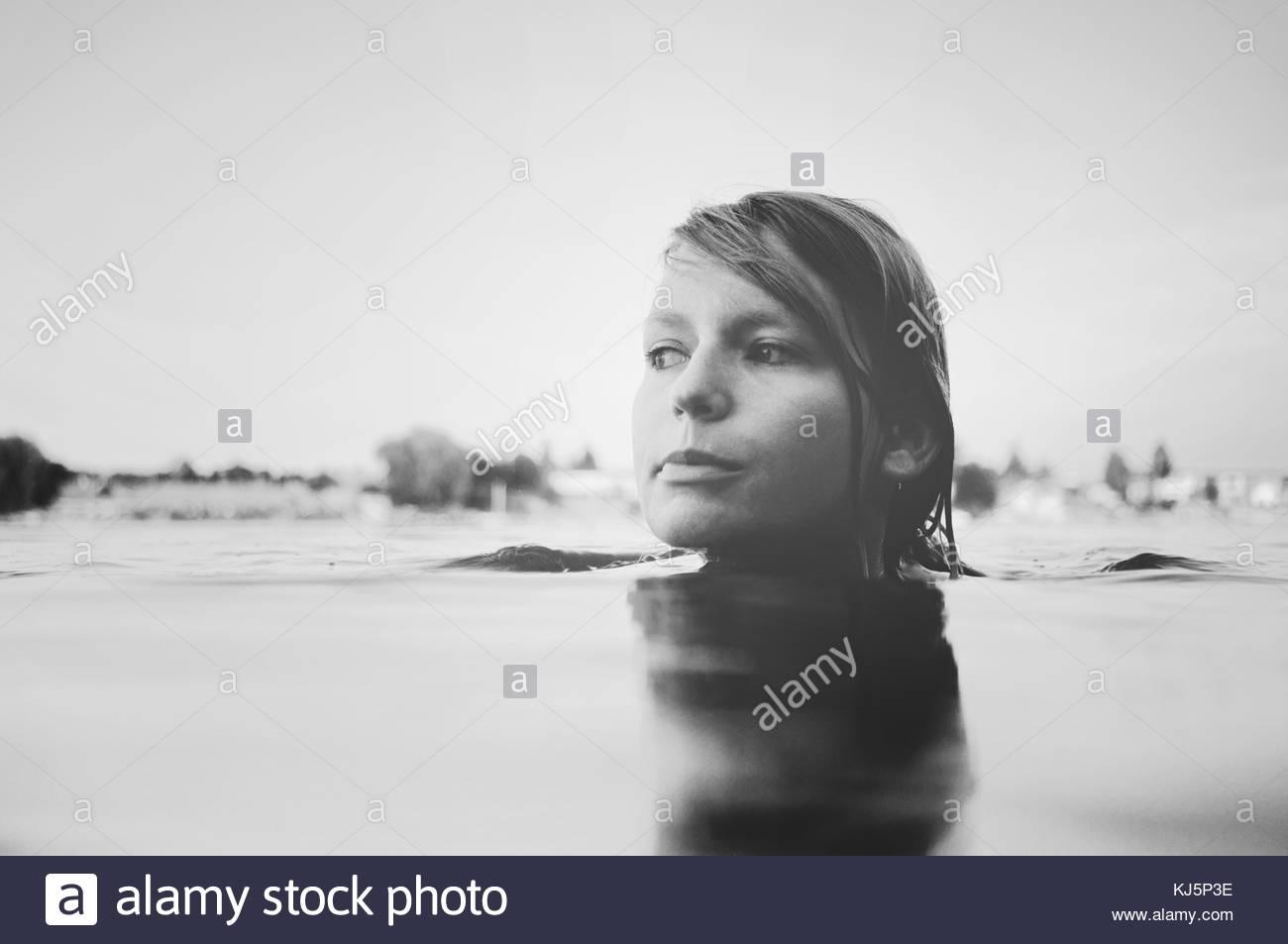 Woman swimming - Stock Image