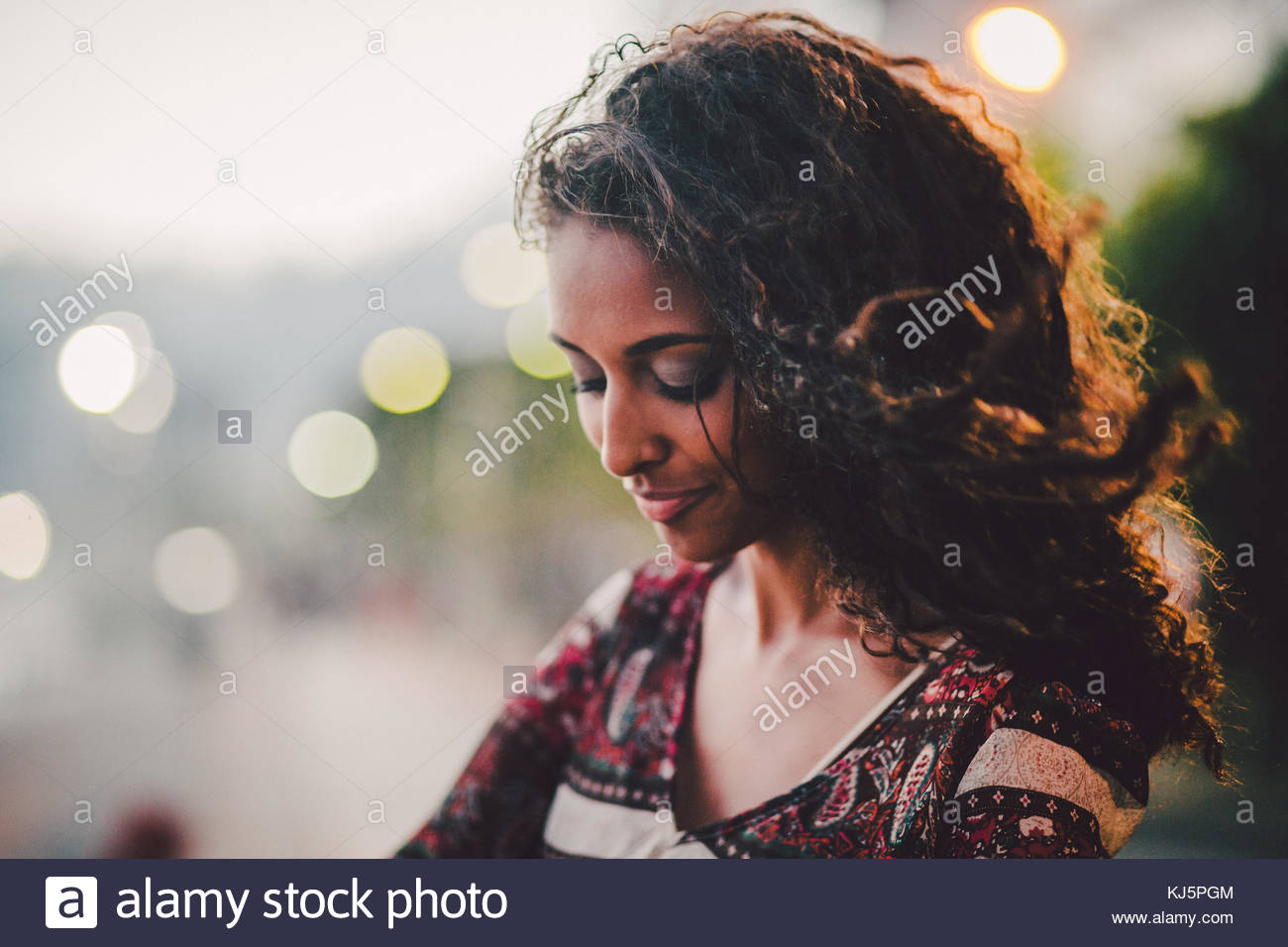 Beautiful portrait of a black woman looking down - Stock Image