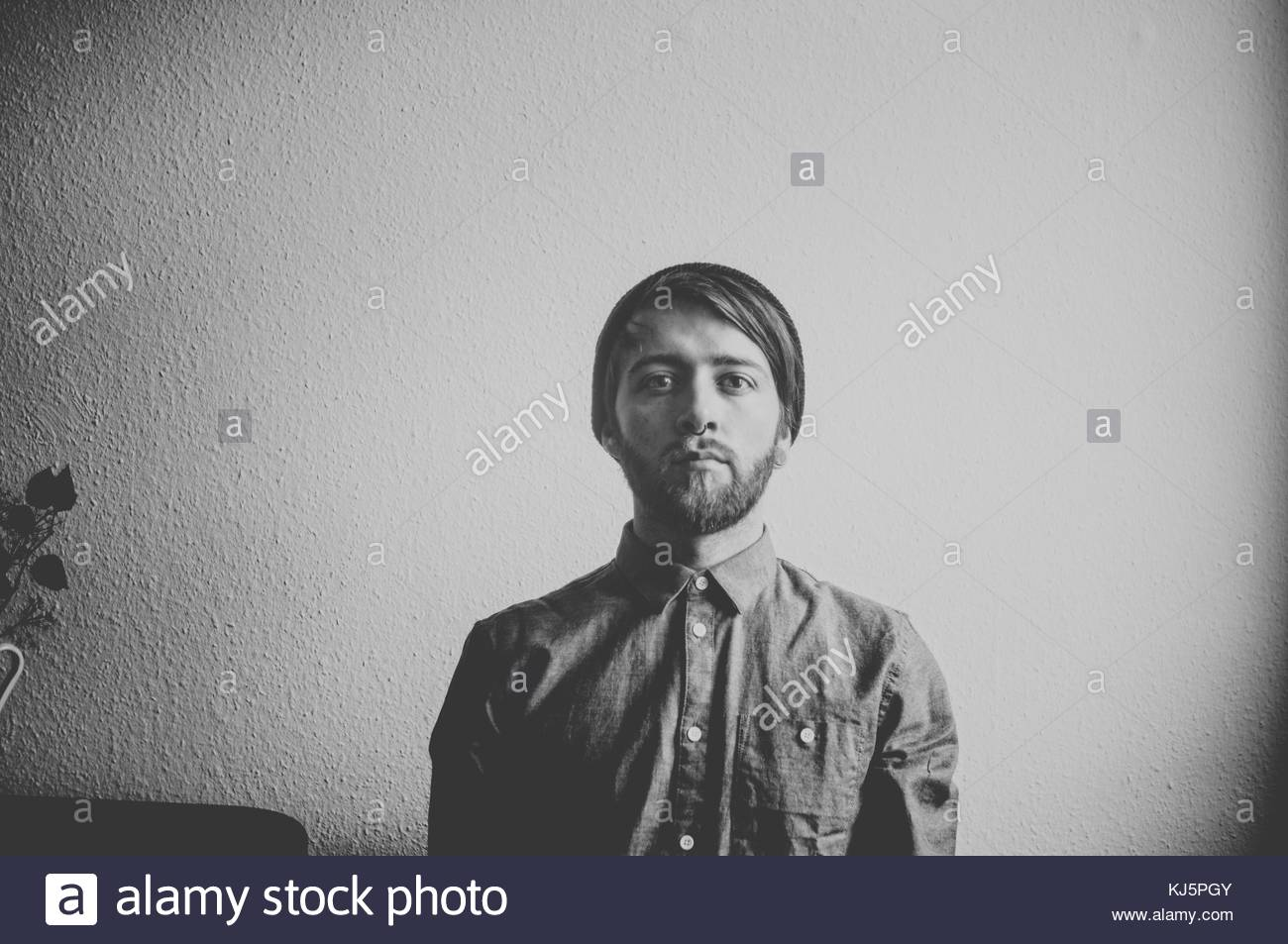 Portrait of young man in shirt - Stock Image
