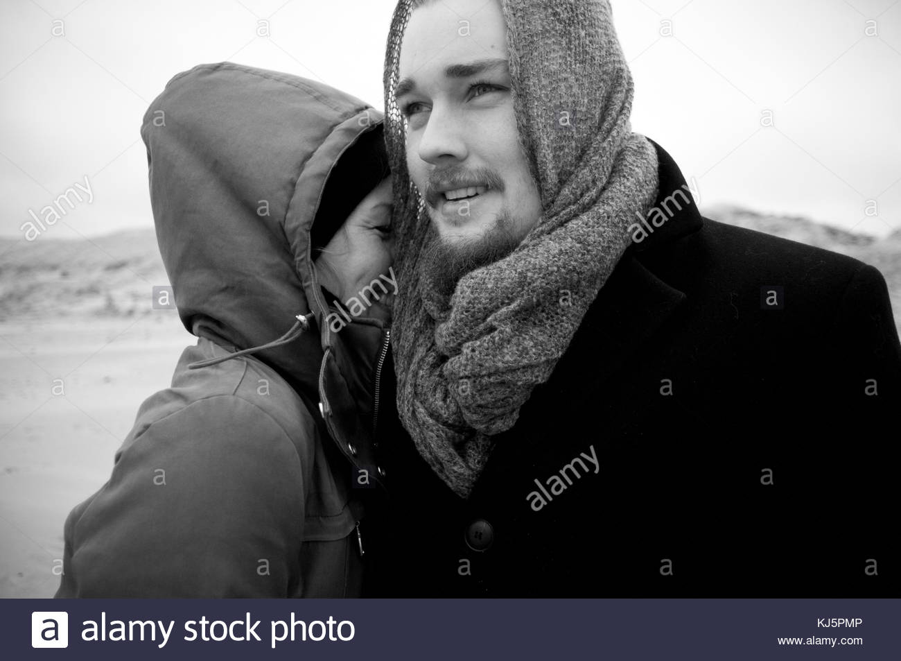 Happy couple in winter clothing - Stock Image
