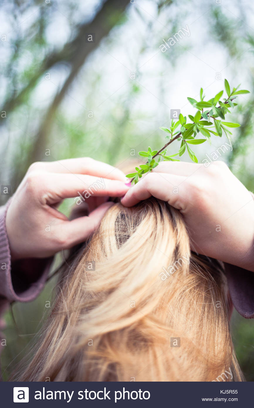 natural leaf decorate woman's hair - Stock Image