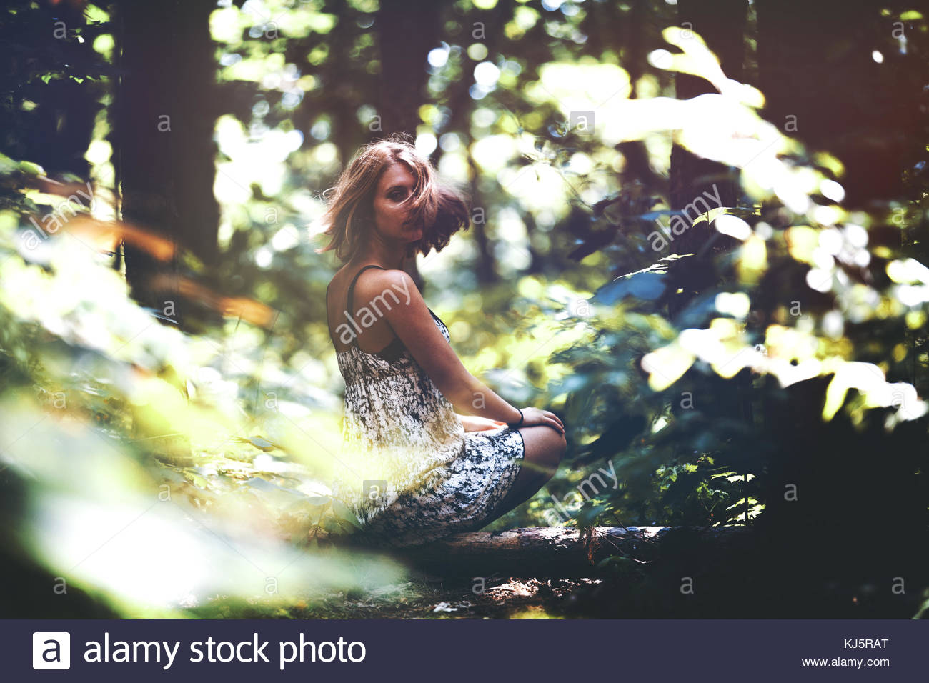 Young woman in forest - Stock Image