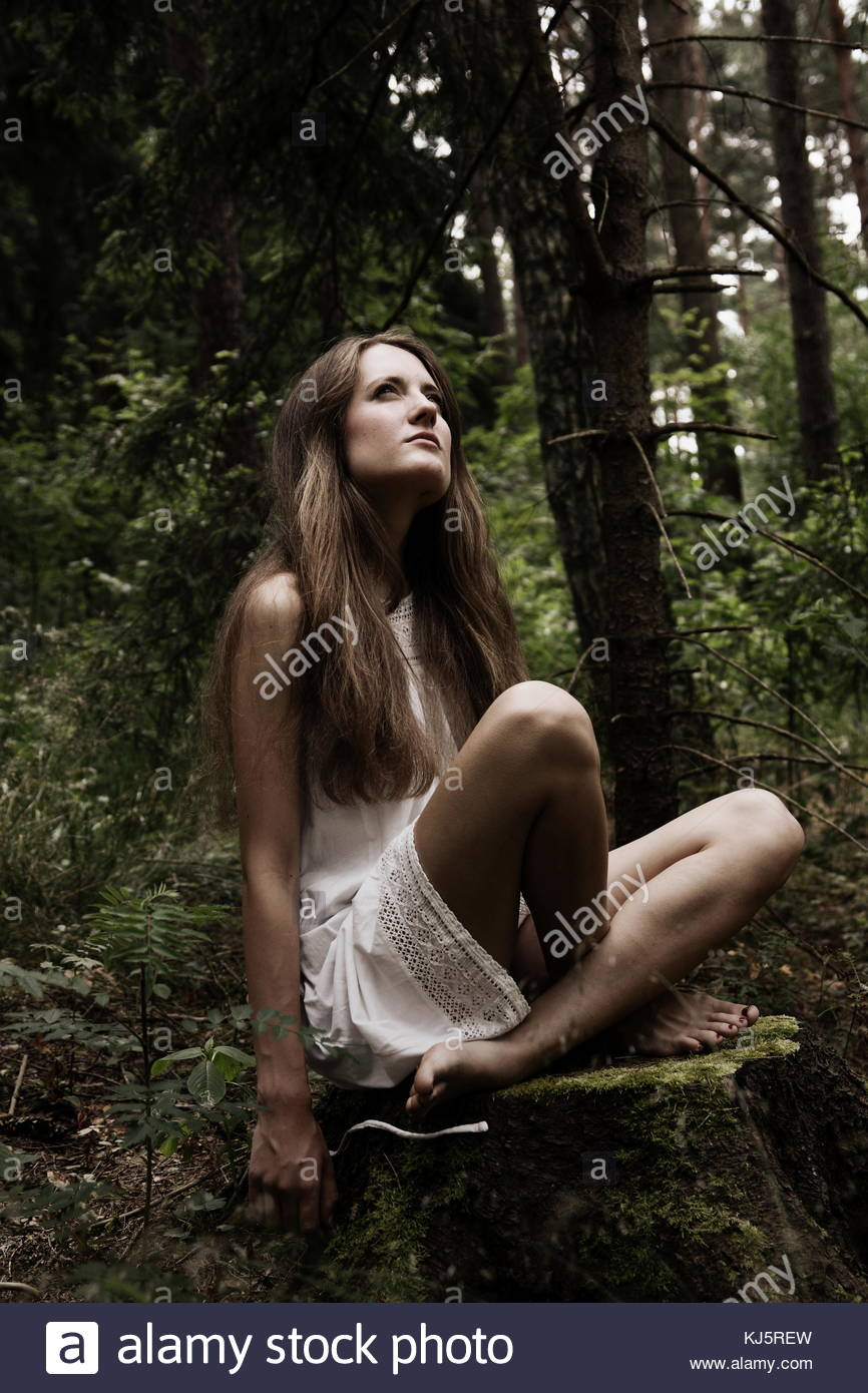 Beautiful woman in the forest - Stock Image