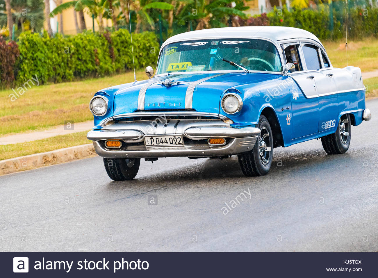 Old classic cars driving or in action. Cuba is known for the many ...