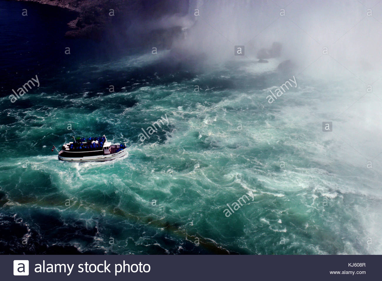 Tour boat by Niagra Falls - Stock Image