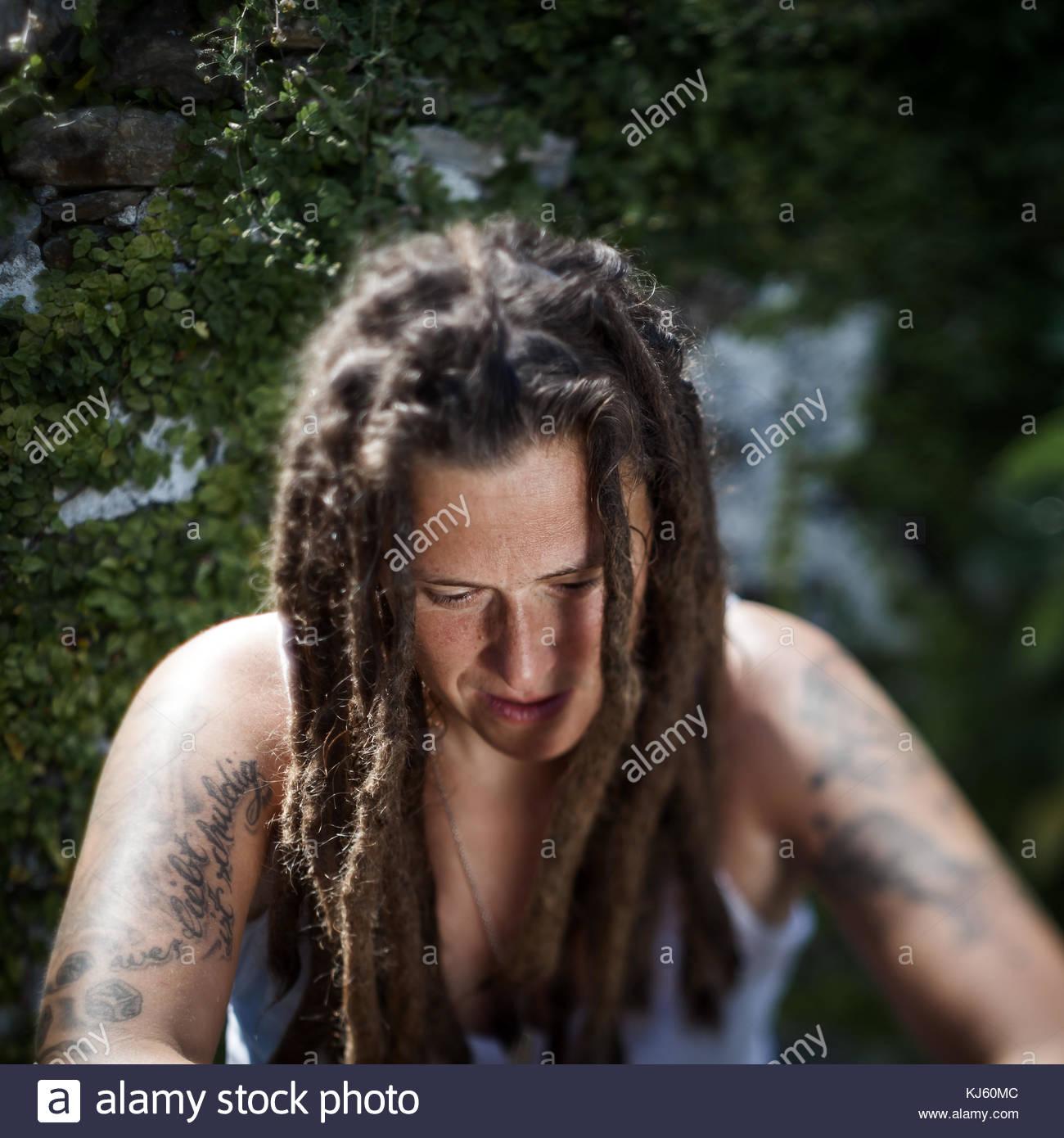 dreadlock woman - Stock Image