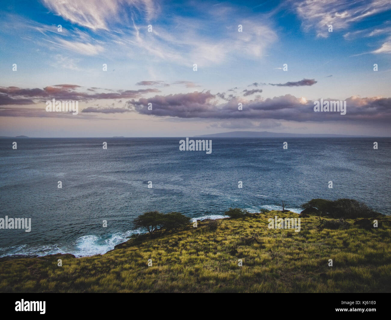 Colorful coastal sunset at Whale Lookout Point on the coast of Maui, Hawaii Stock Photo