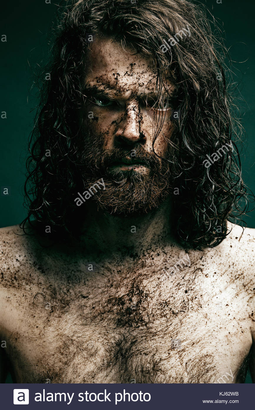 hirsute young man with long hair and beard - Stock Image