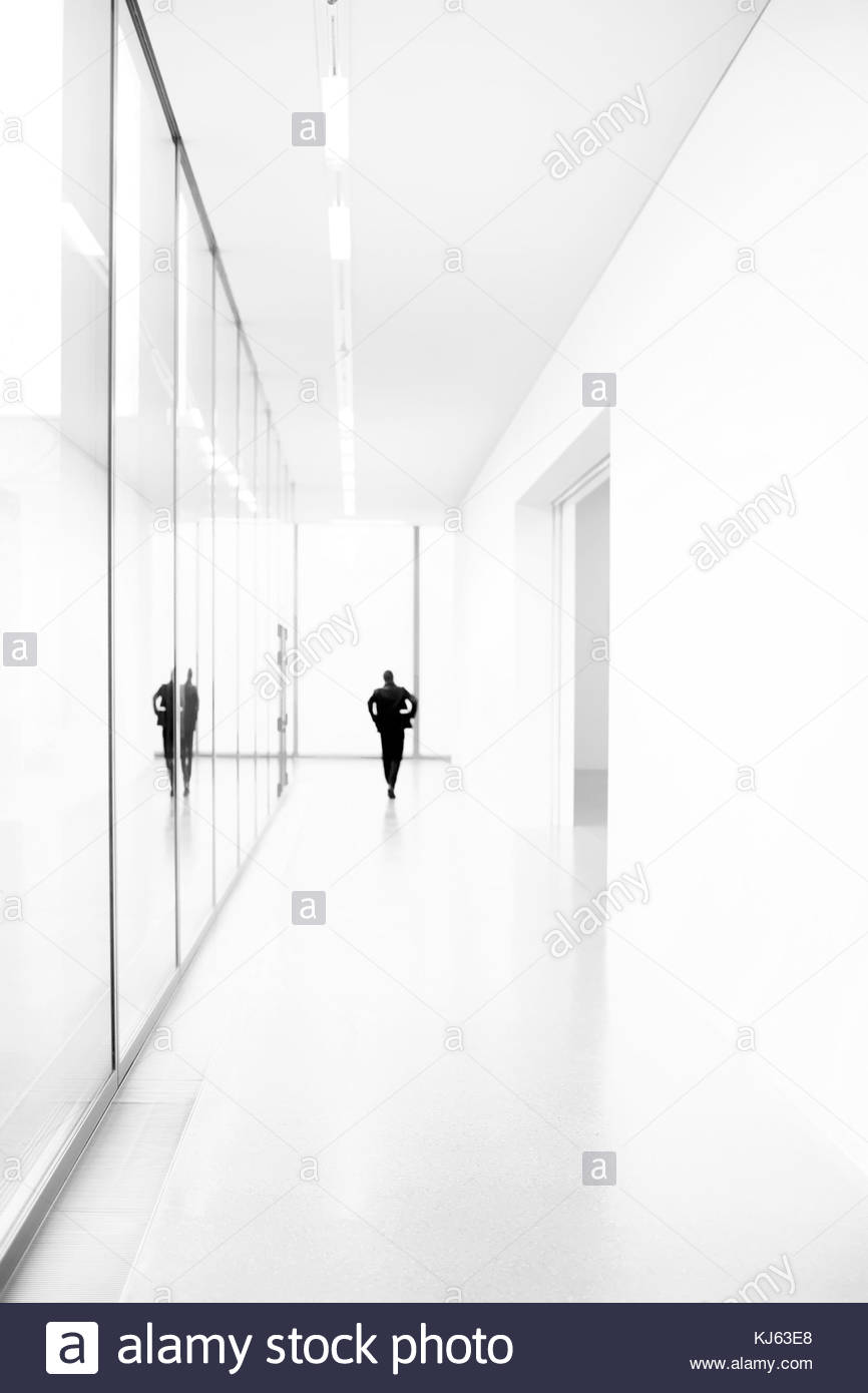 Silhouette in white hallway - Stock Image