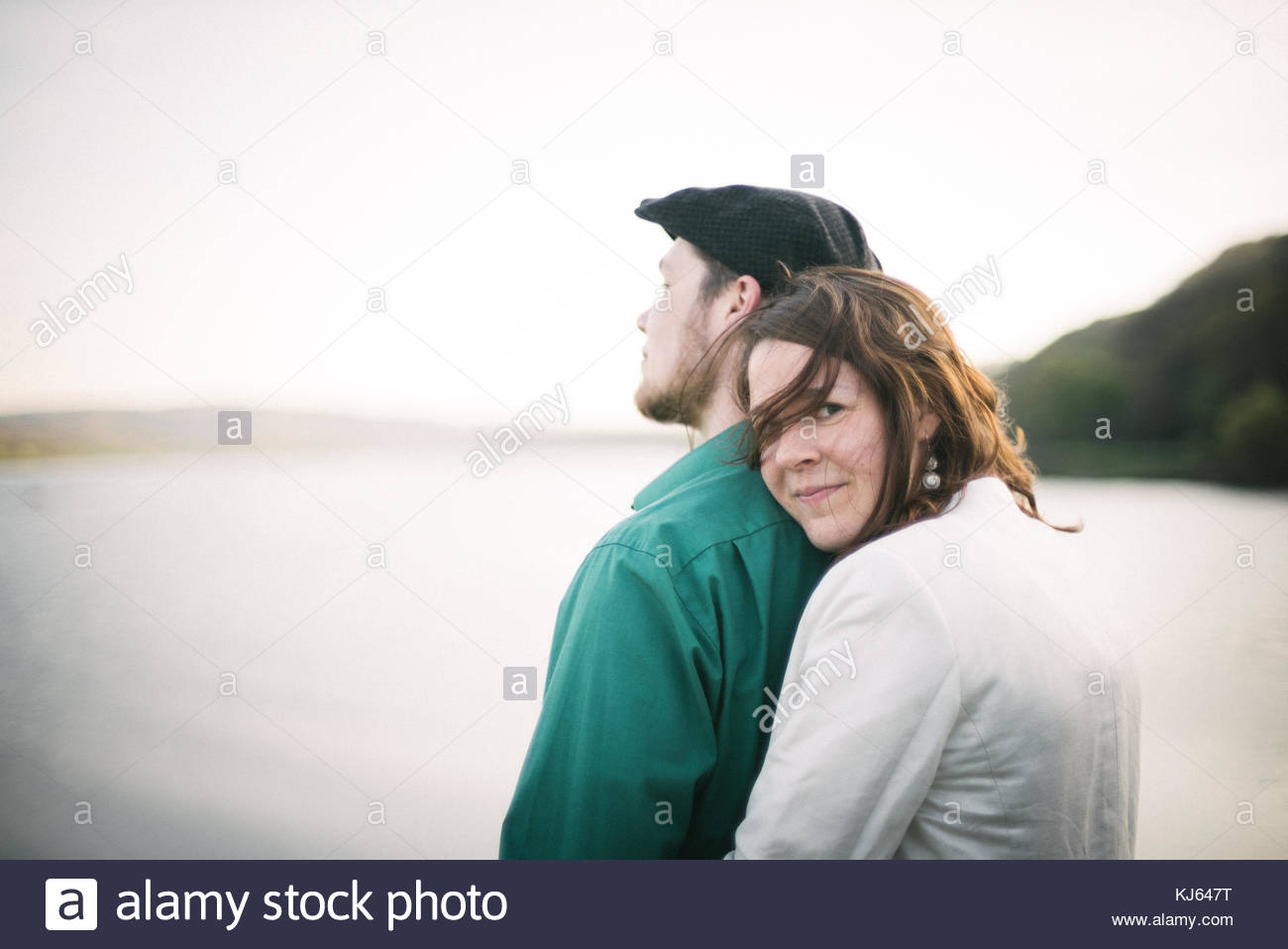 Happy couple by the water - Stock Image