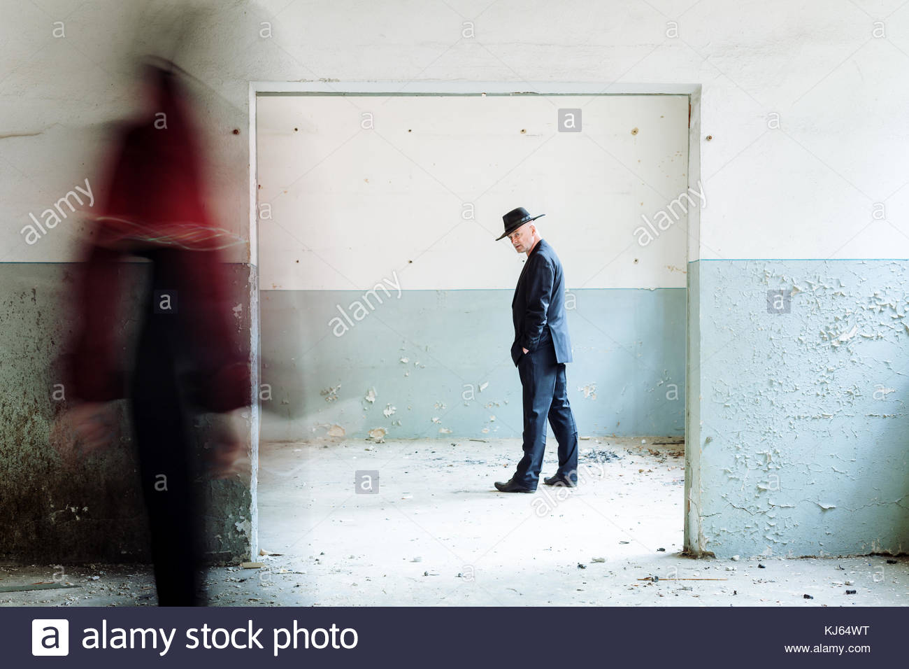 surreal man in hat blurred figure Stock Photo