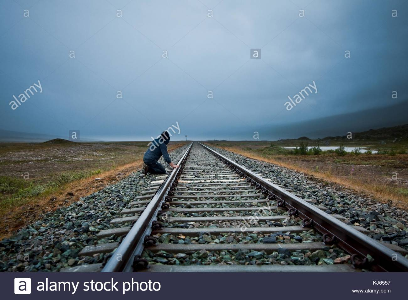 person beside rail track - Stock Image