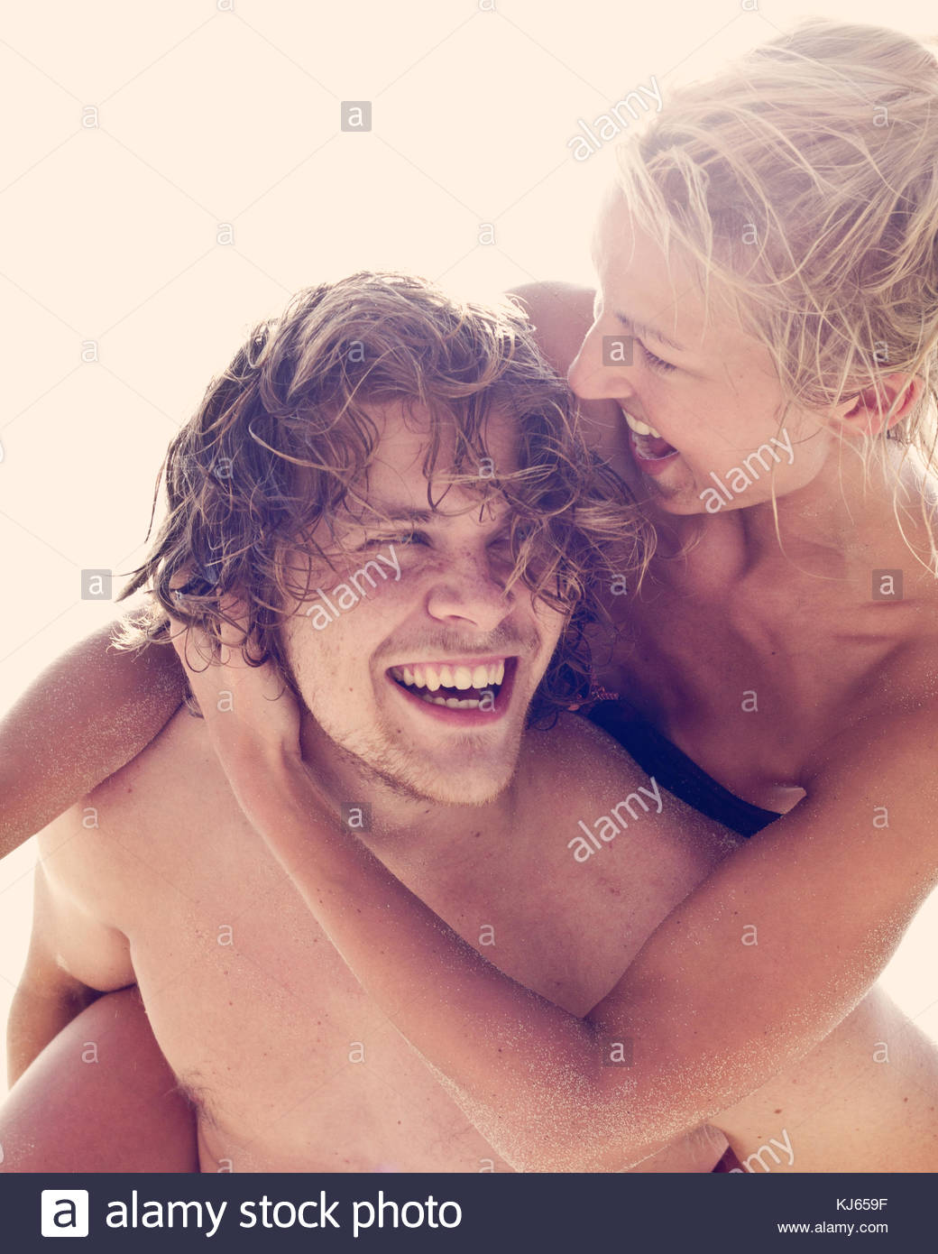 couple playing in the sun - Stock Image