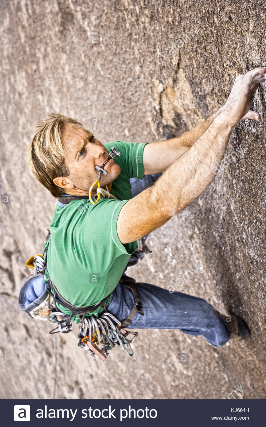 Climber holds on tight - Stock Image