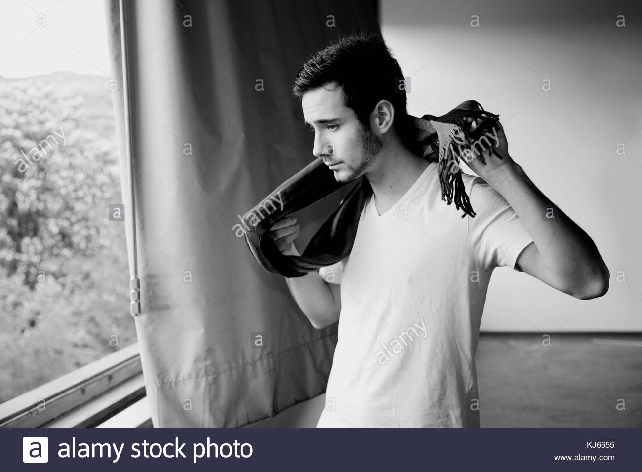 Young man with scarf - Stock Image