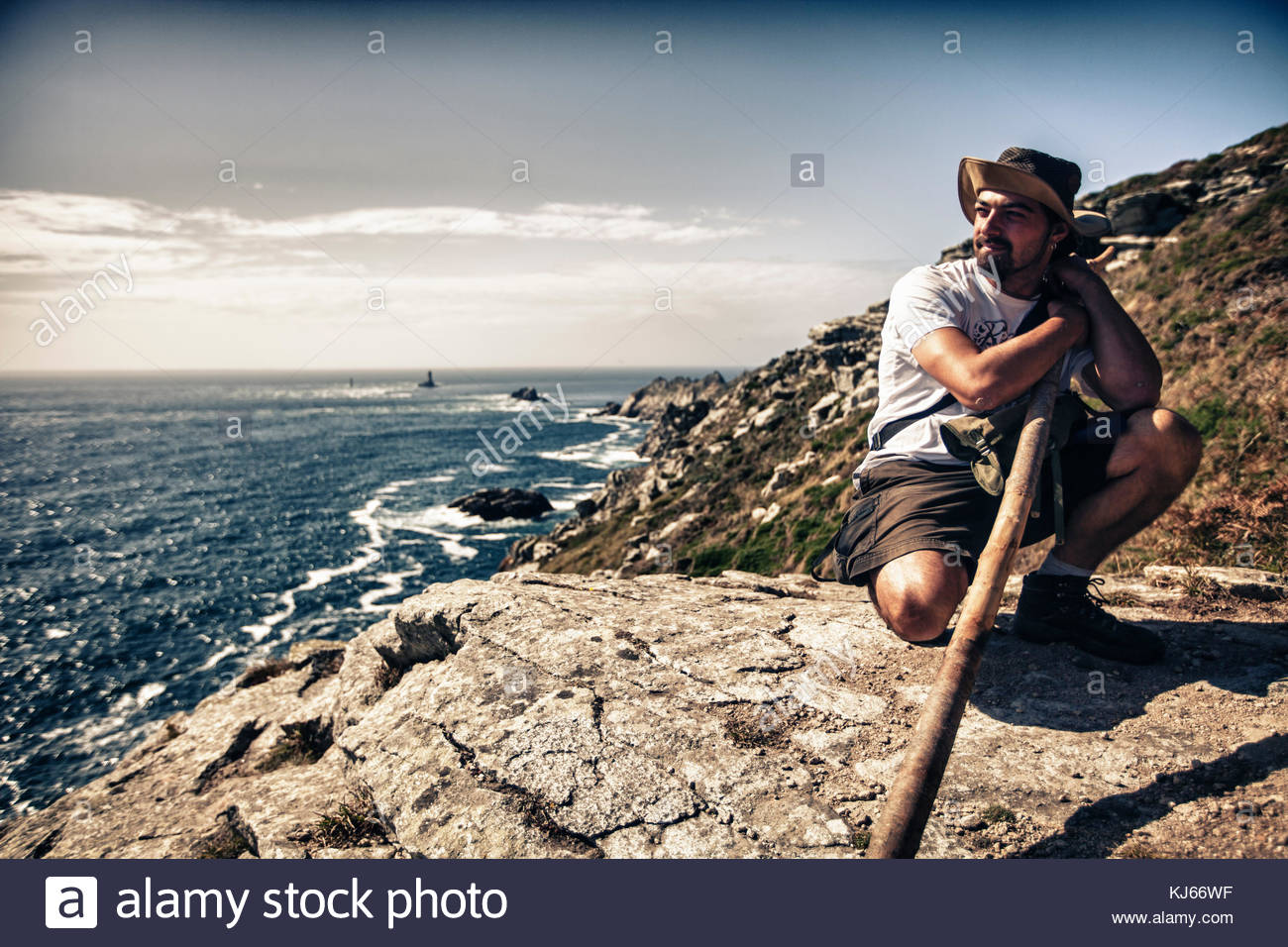 Young man on cliff - Stock Image