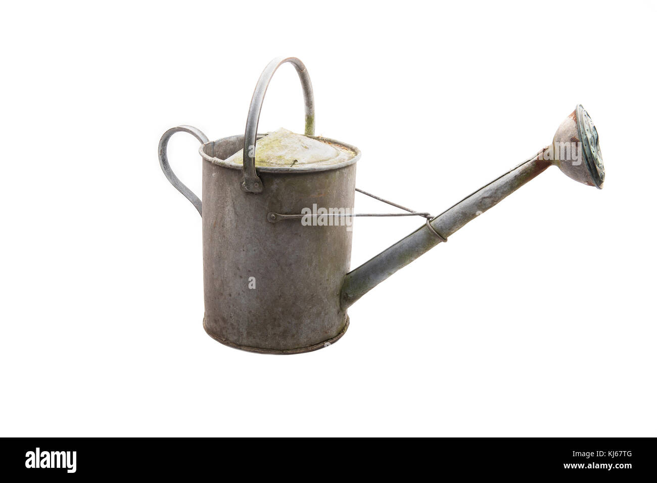 An old galvanized zinc watering can with rust isolated on white - Stock Image
