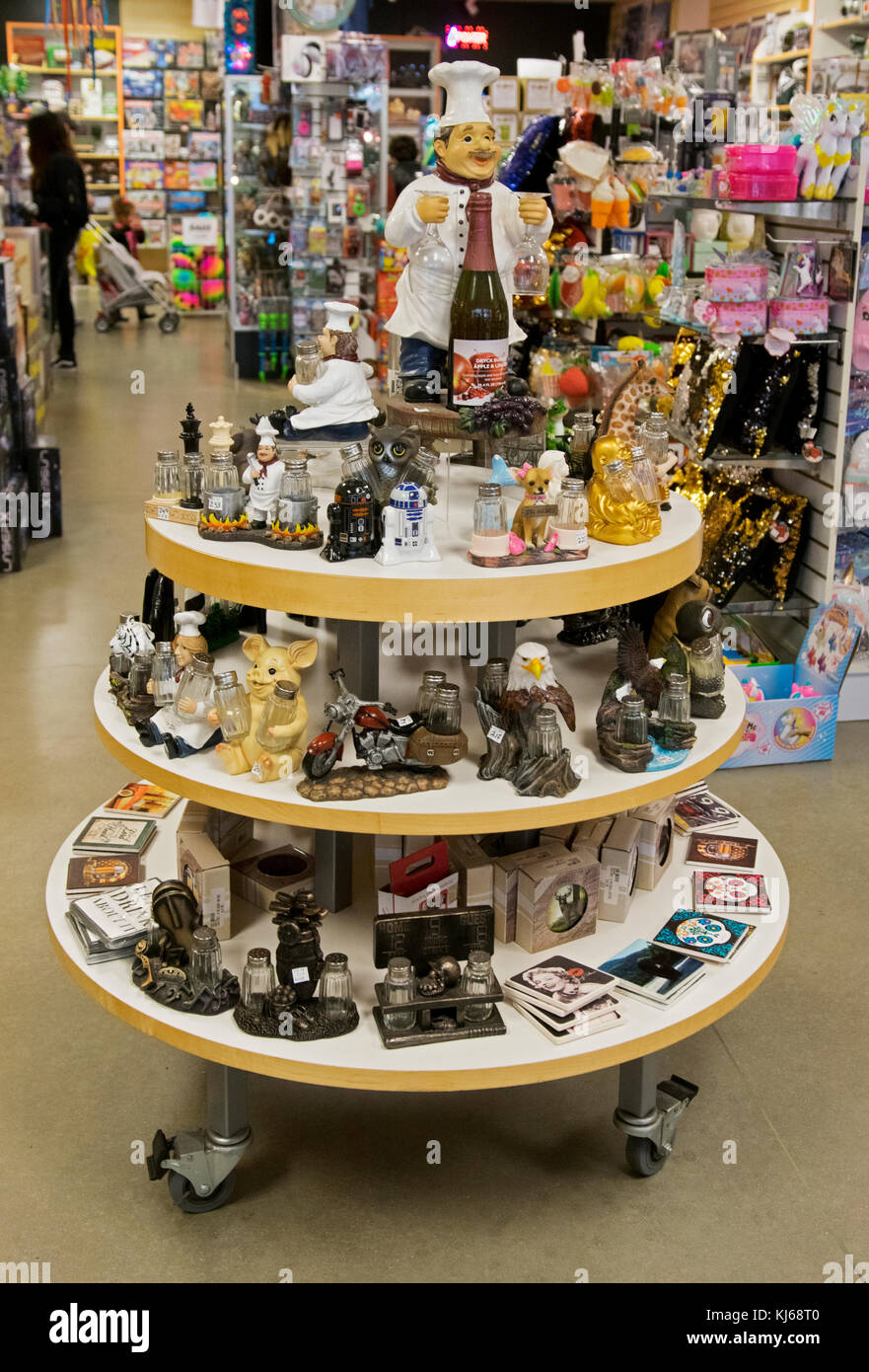 Various clever ceramic salt and pepper shakers for sale at Gizmos & Gadgets at the Tanger Outlet Mall in Deer - Stock Image