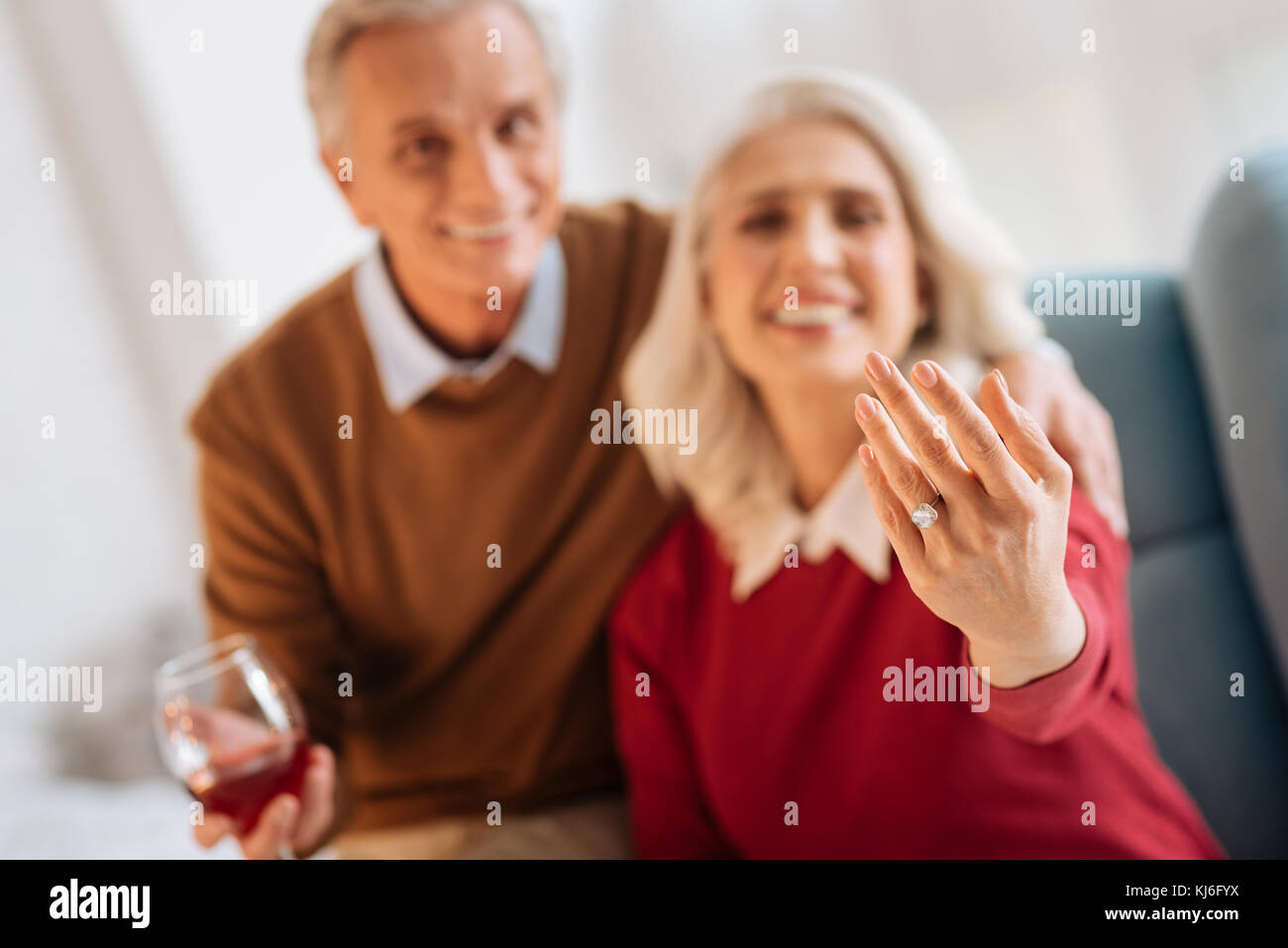 Radiant senior woman and man smiling after their engagement - Stock Image