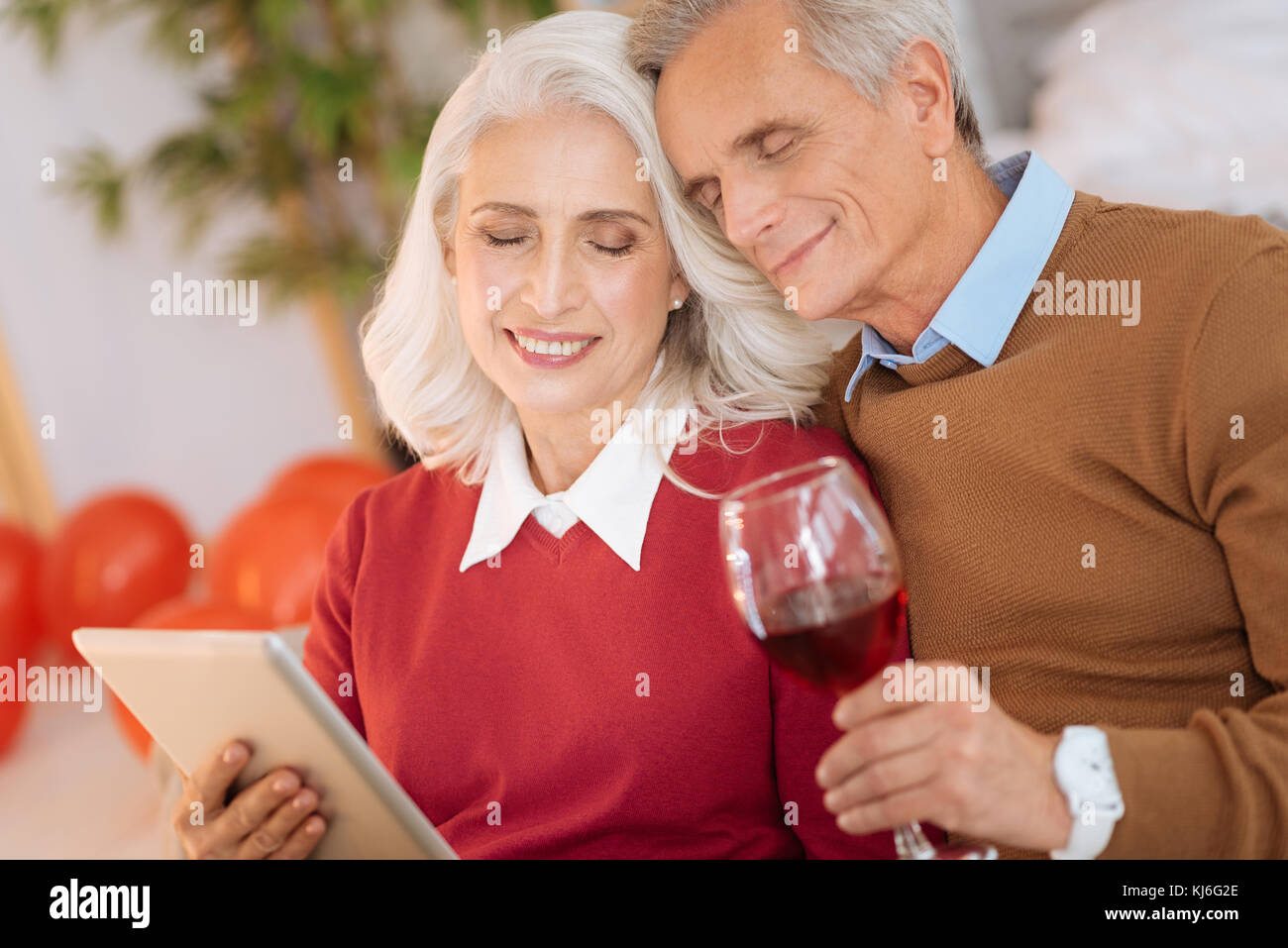 Loving retired husband and wife enjoying their moment together - Stock Image