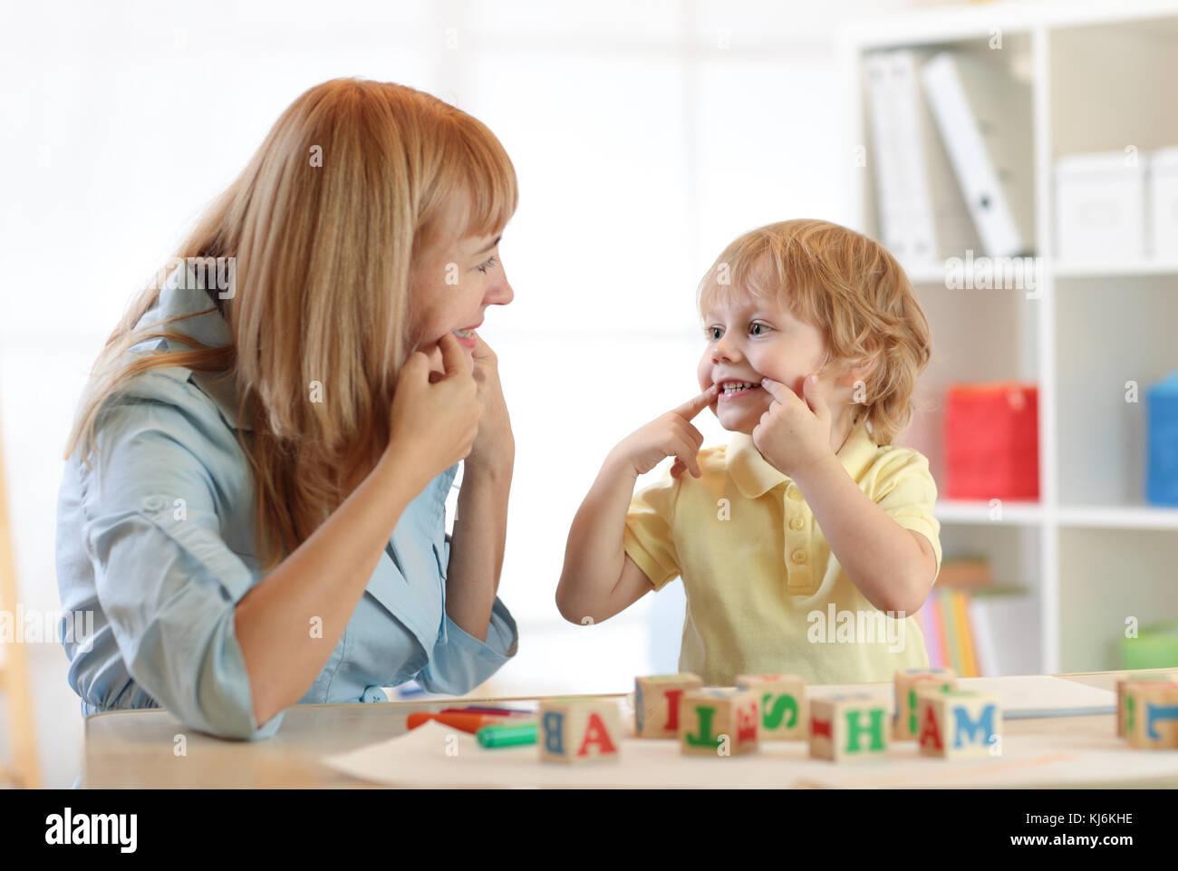 Cute kid little boy at speech therapist office - Stock Image