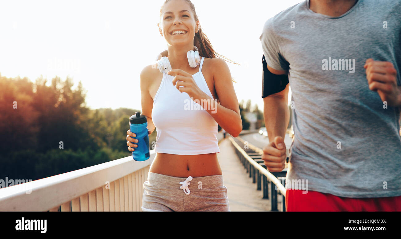 Attractive man and beautiful woman jogging together - Stock Image