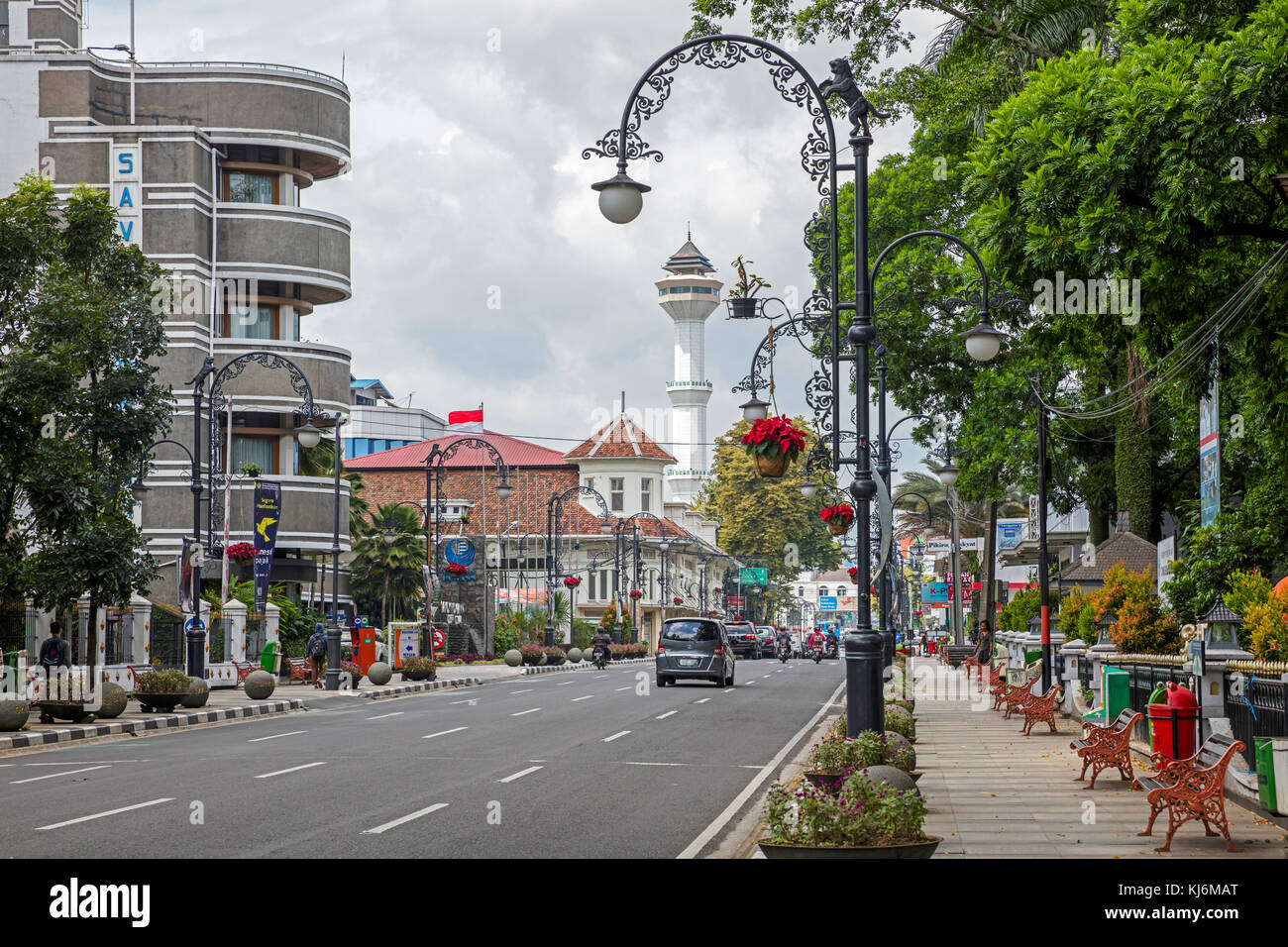 Minaret of the Grand Mosque of Bandung and Savoy Homann Bidakara Hotel in the Jalan Asia-Afrika street in the city - Stock Image