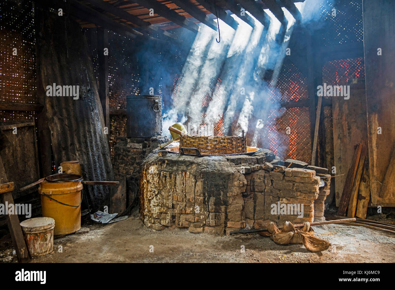 Primitive palm sugar factory boiling the collected sap near Pangandaran, West Java, Indonesia - Stock Image
