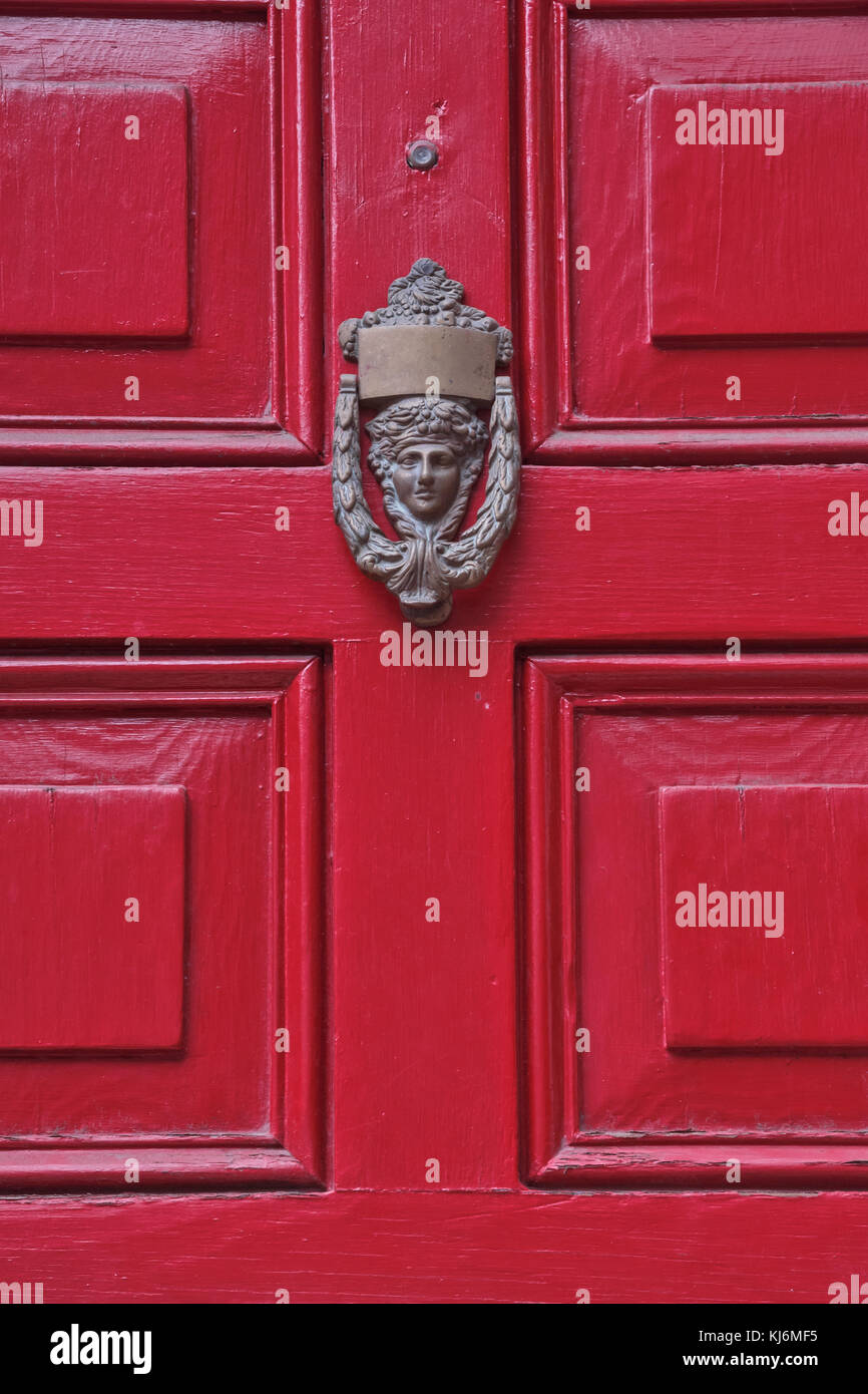 Bright colorful door with antique door knob of ancient house, Philadelphia, Pennsylvania, USA - Stock Image