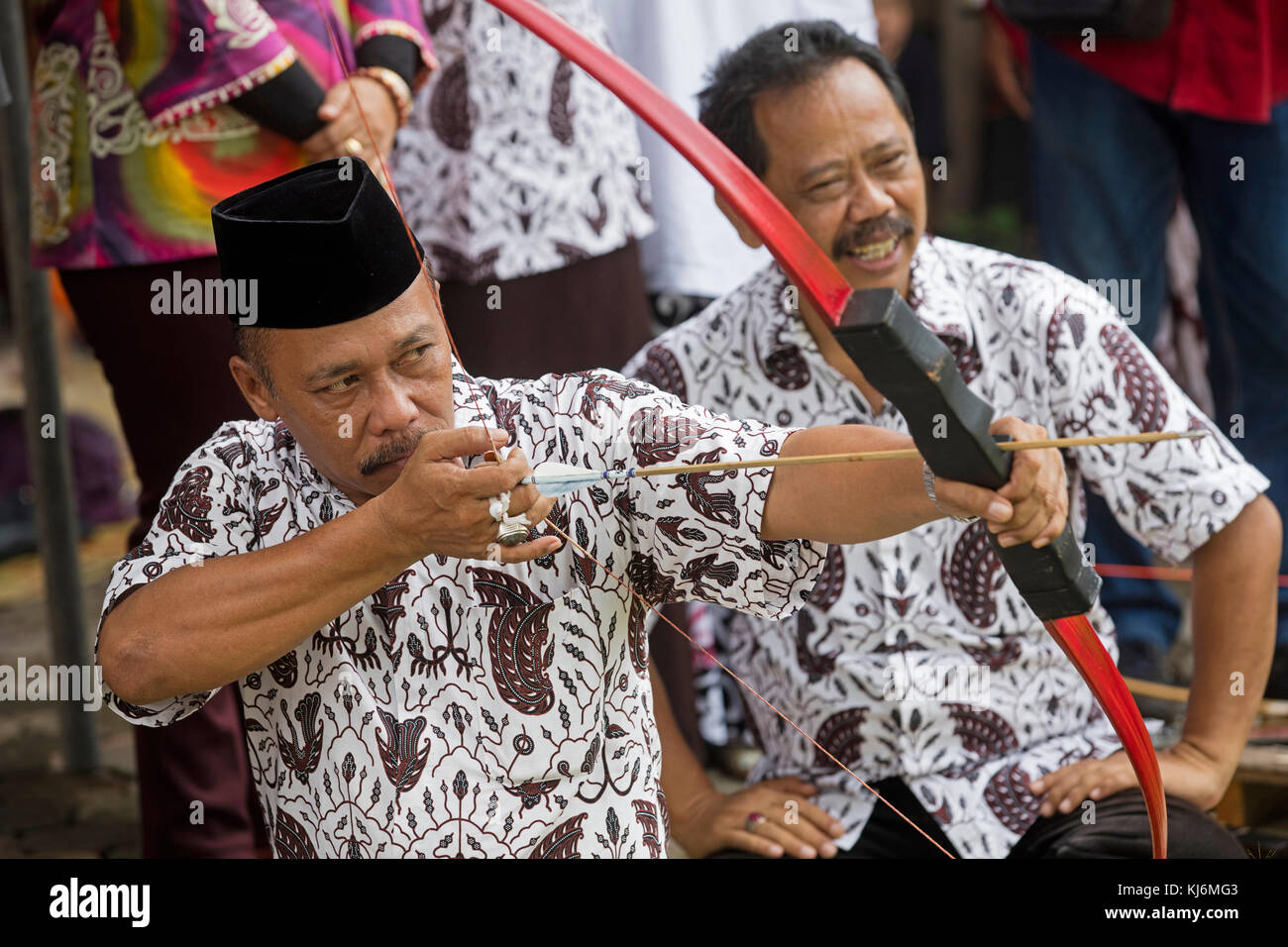Mayor of the city Yogyakarta practicing Jemparingan / traditional Javanese archery by shooting bow and arrows, Java, - Stock Image