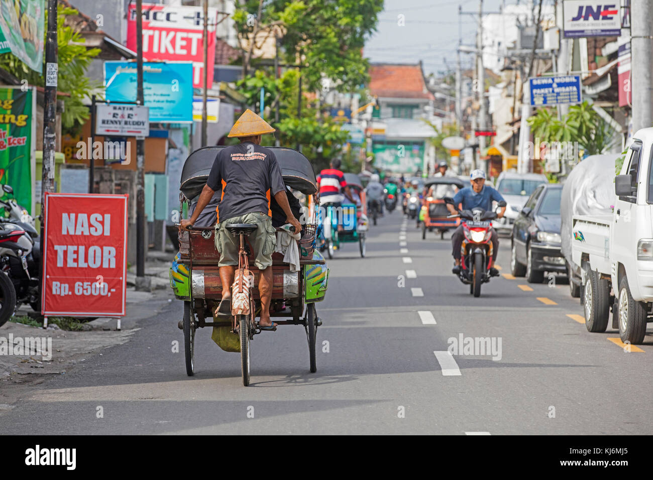Cycle rickshaws / becak for public transport in the city Yogyakarta, Java, Indonesia - Stock Image