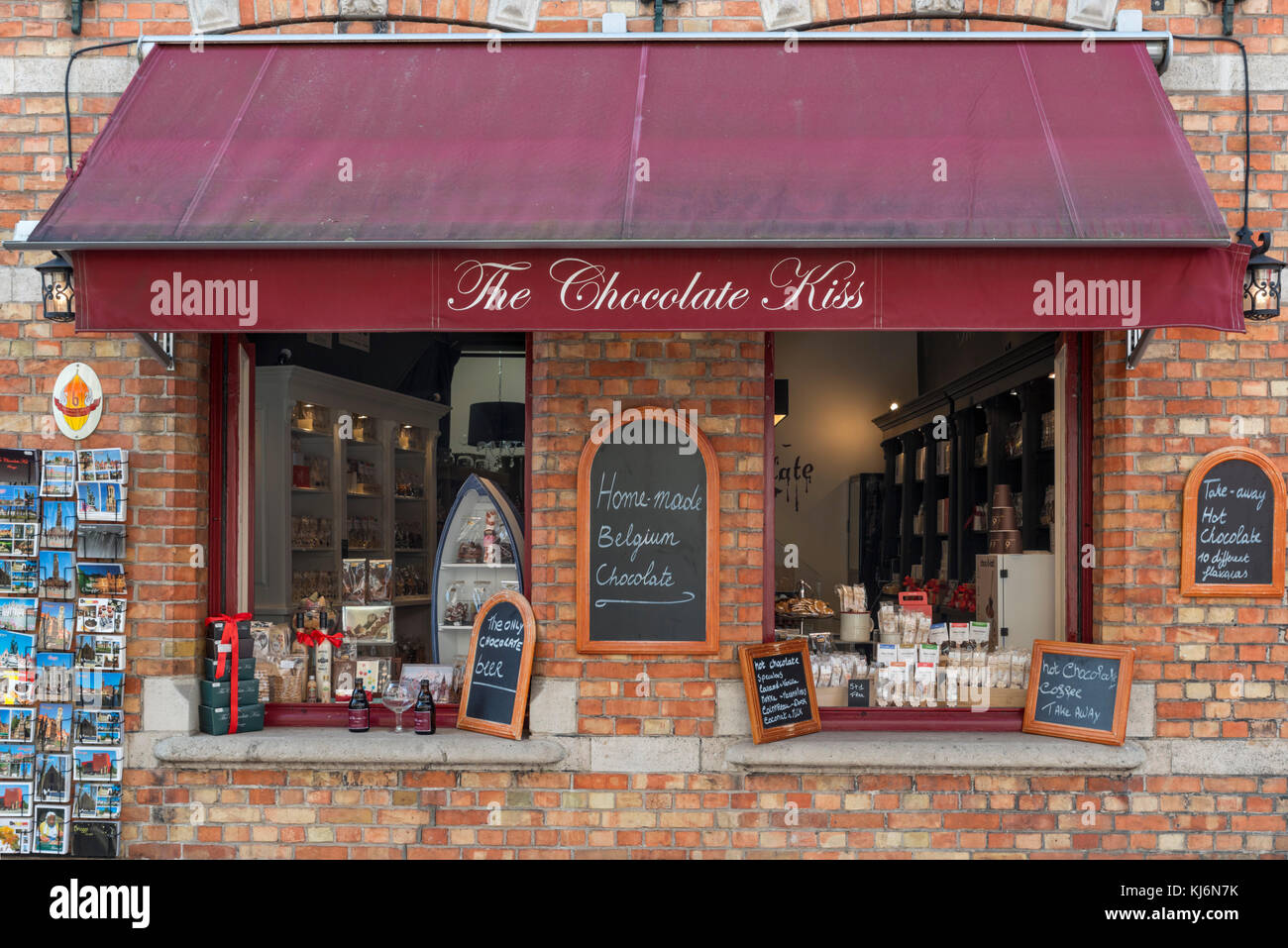 Chocolate shop selling Belgian chocolates in Bruges (Brugge), Belgium. - Stock Image