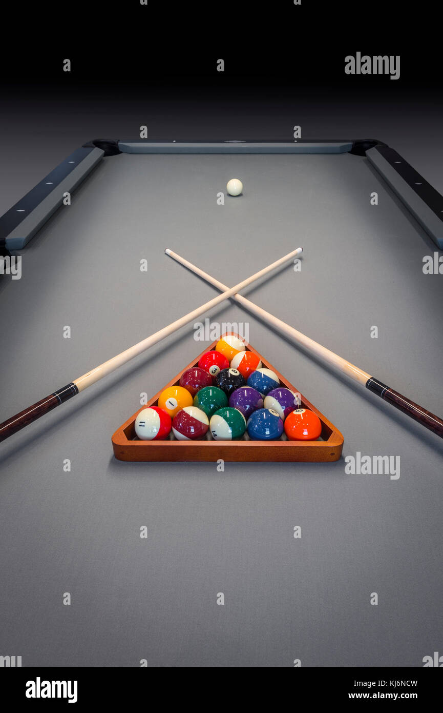 Cue Sticks & Balls On Billiard Table - Stock Image