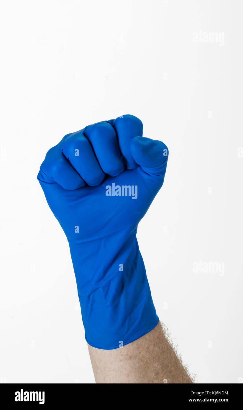 Blue Glove Gloved Hand Making Fist - Stock Image