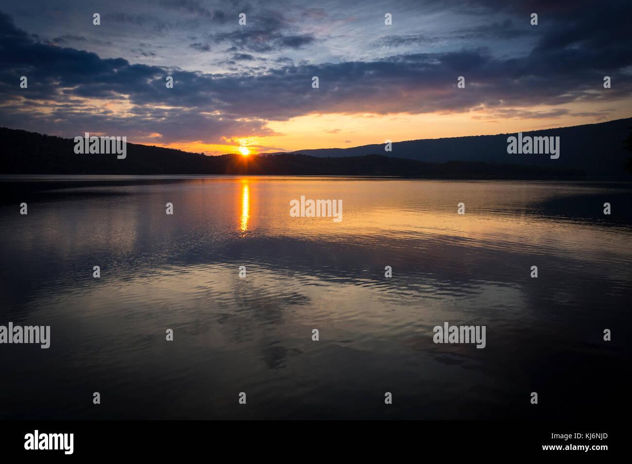 Sun Setting On Mountain Lake, Pennsylvania, USA - Stock Image