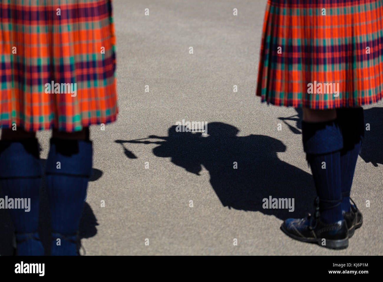Shadow of a man wearing a kilt and playing bagpipes - Stock Image