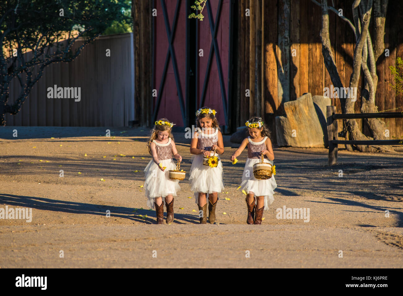 9c1fe302f0800 Flower girls in boots and white dress at desert wedding Stock Photo ...