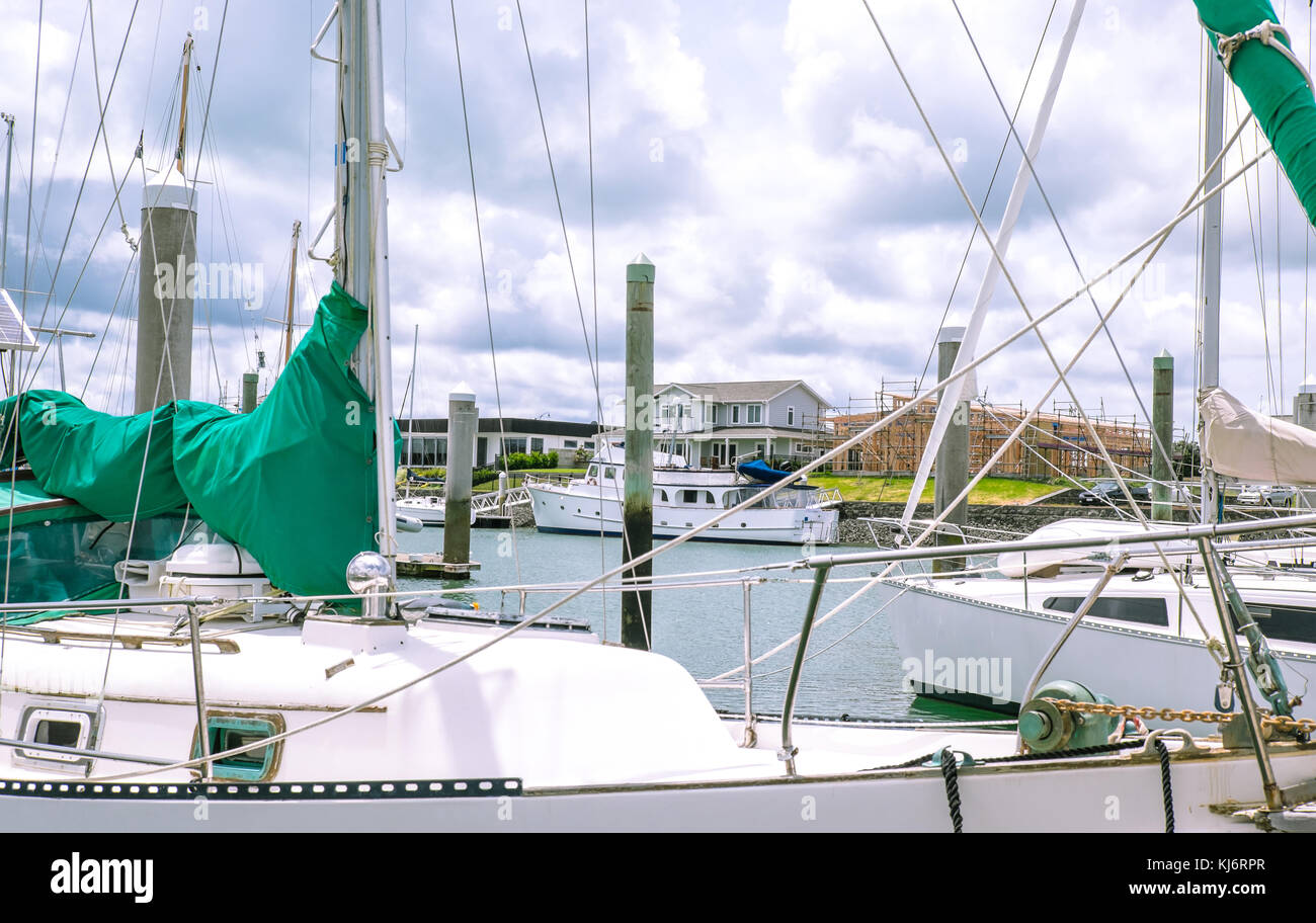 Looking through sailboat yacht masts and rigging to new