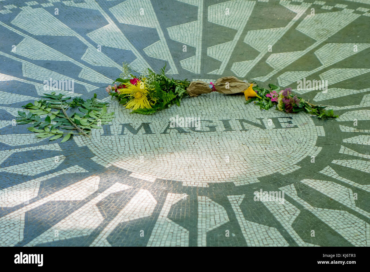 NEW YORK, USA - NOVEMBER 22, 2016: Strawberry Fields mosaic in the floor of Central park in New York City, USA - Stock Image