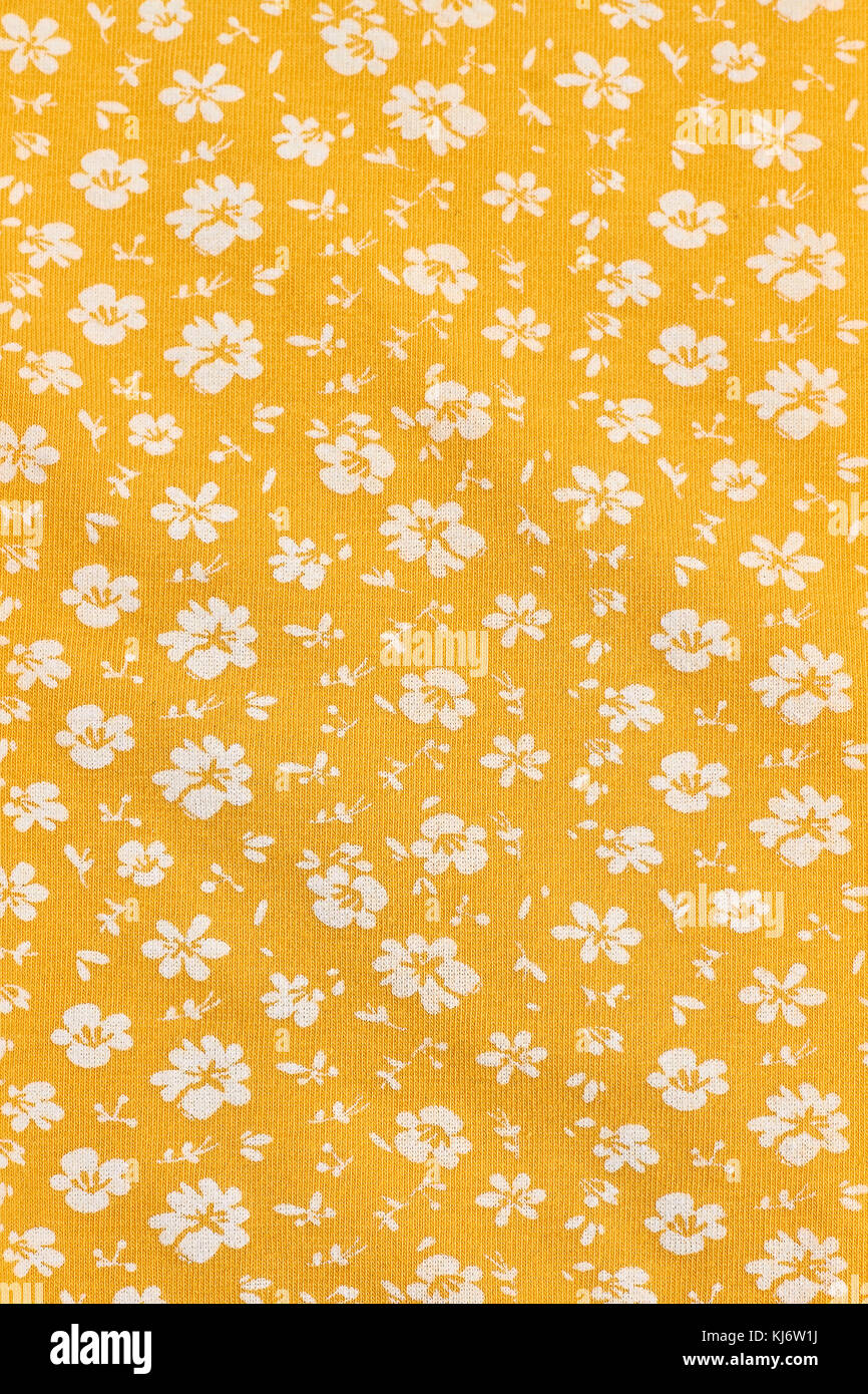 Textile wallpaper in floral print. Yellow fabric background in small ...