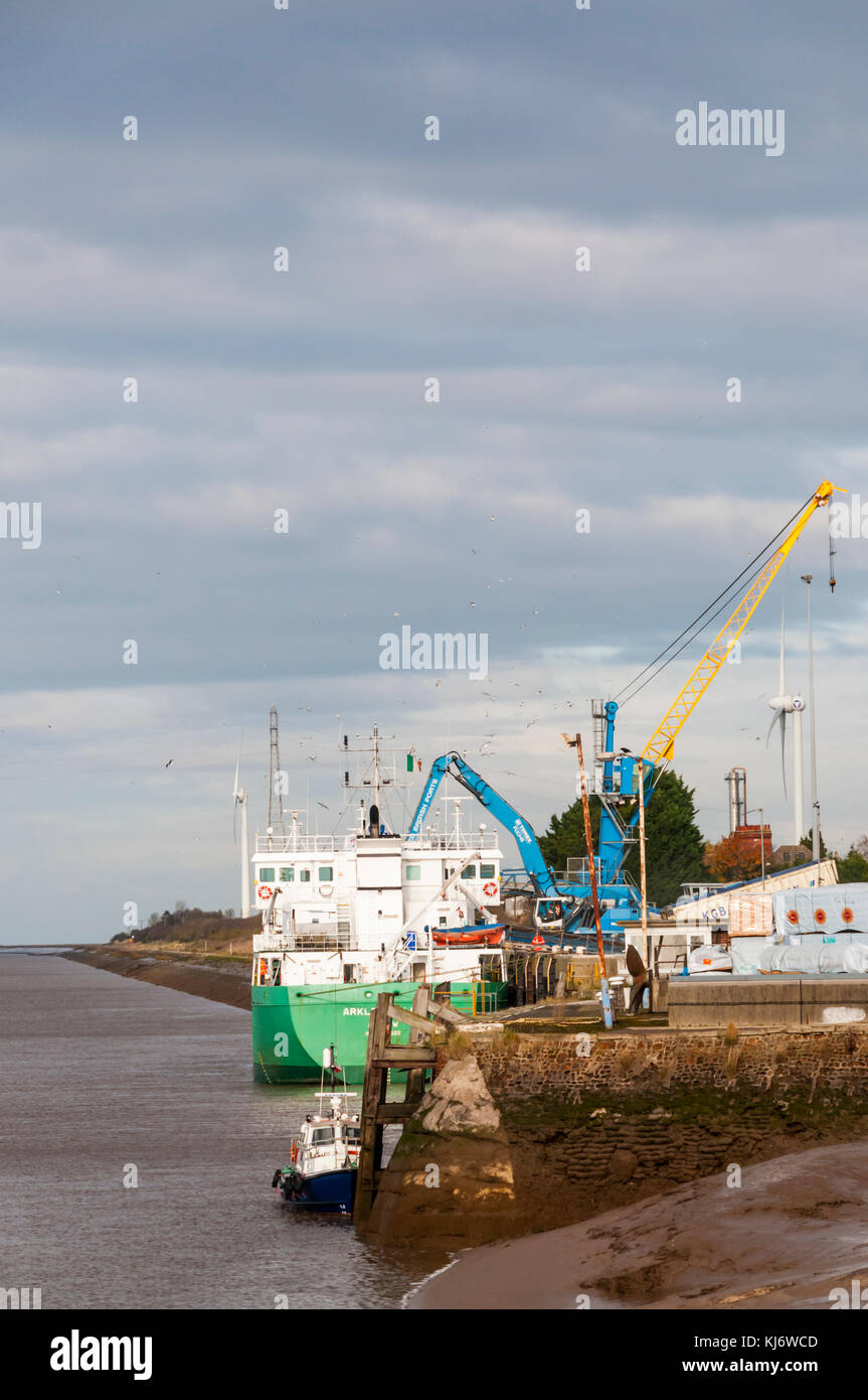 The general cargo ship Arklow Ruler being unloaded from a berth on the River Great Ouse at King's Lynn docks. - Stock Image