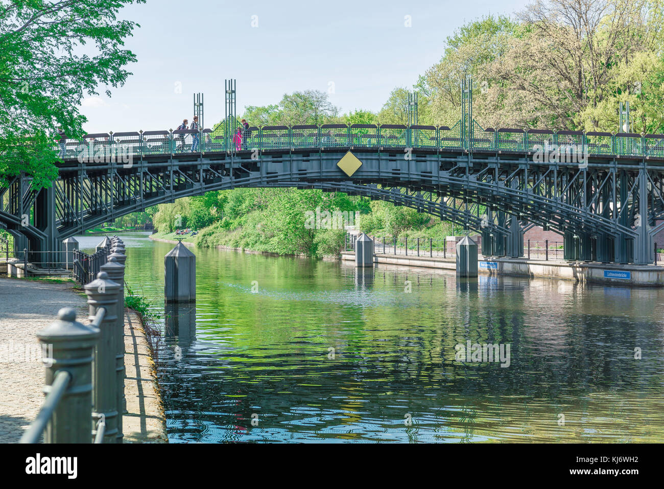 Berlin spring, the bridge spanning the Landwehrkanal at the Neuer See entrance to the Tiergarten park, Berlin Germany. - Stock Image