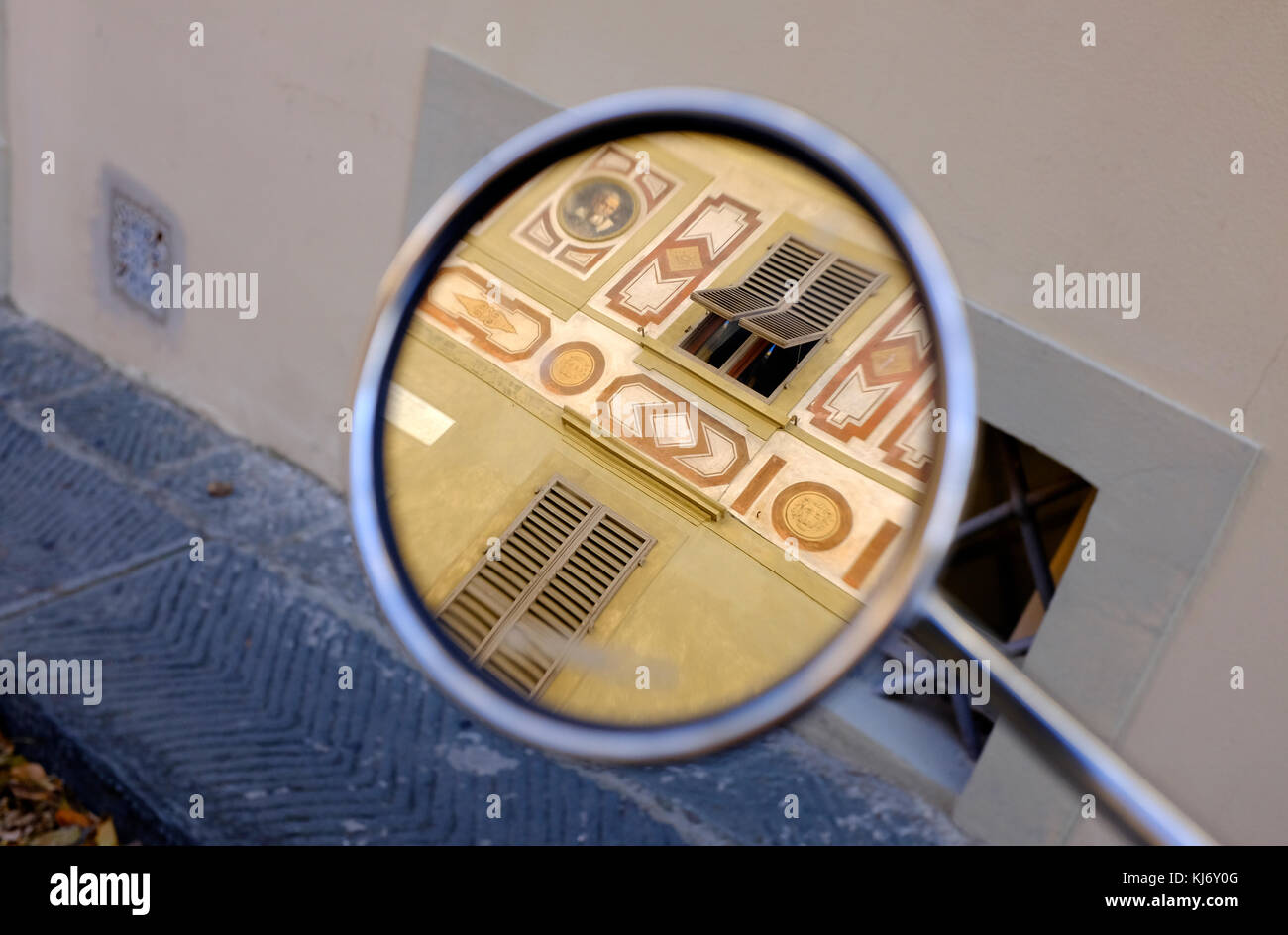 reflection of decorative florentine building in scooter wing mirror, florence, italy - Stock Image