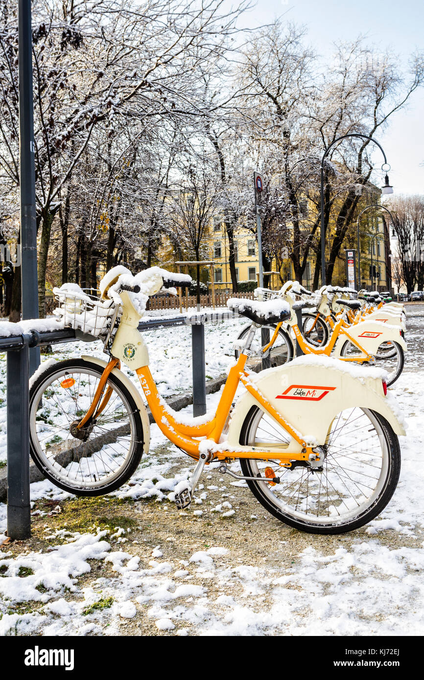 Bicycle for rent covered by snow. Milan, Province of Milan, Italy. - Stock Image