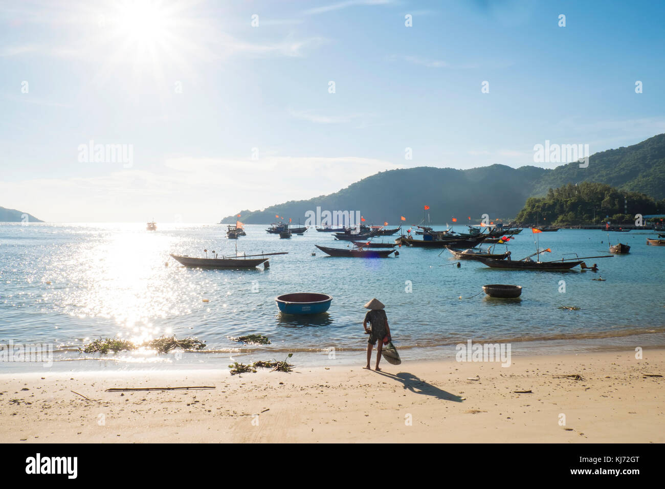 fishing boats off the beach on the Cham Islands in Vietnam - Stock Image