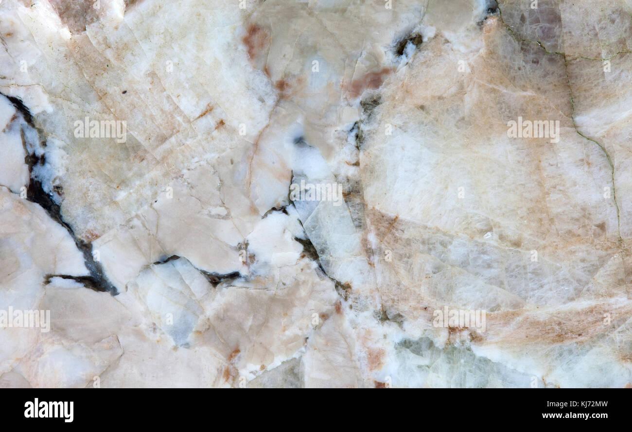 Plagioclase feldspar silicate mica Beryl mineral stones texture pattern macro view. Beautiful natural stony background - Stock Image