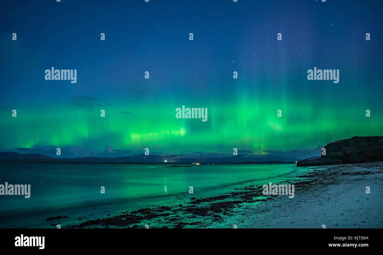 Northern Lights viewed at Ganavan Sands near Oban on the West Coast of Scotland in November 2017 - Stock Image