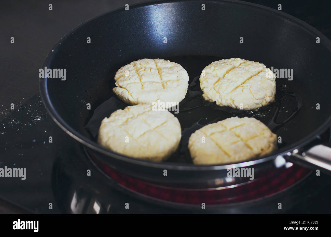 The cottage cheese pancakes fried in a pan - Stock Image