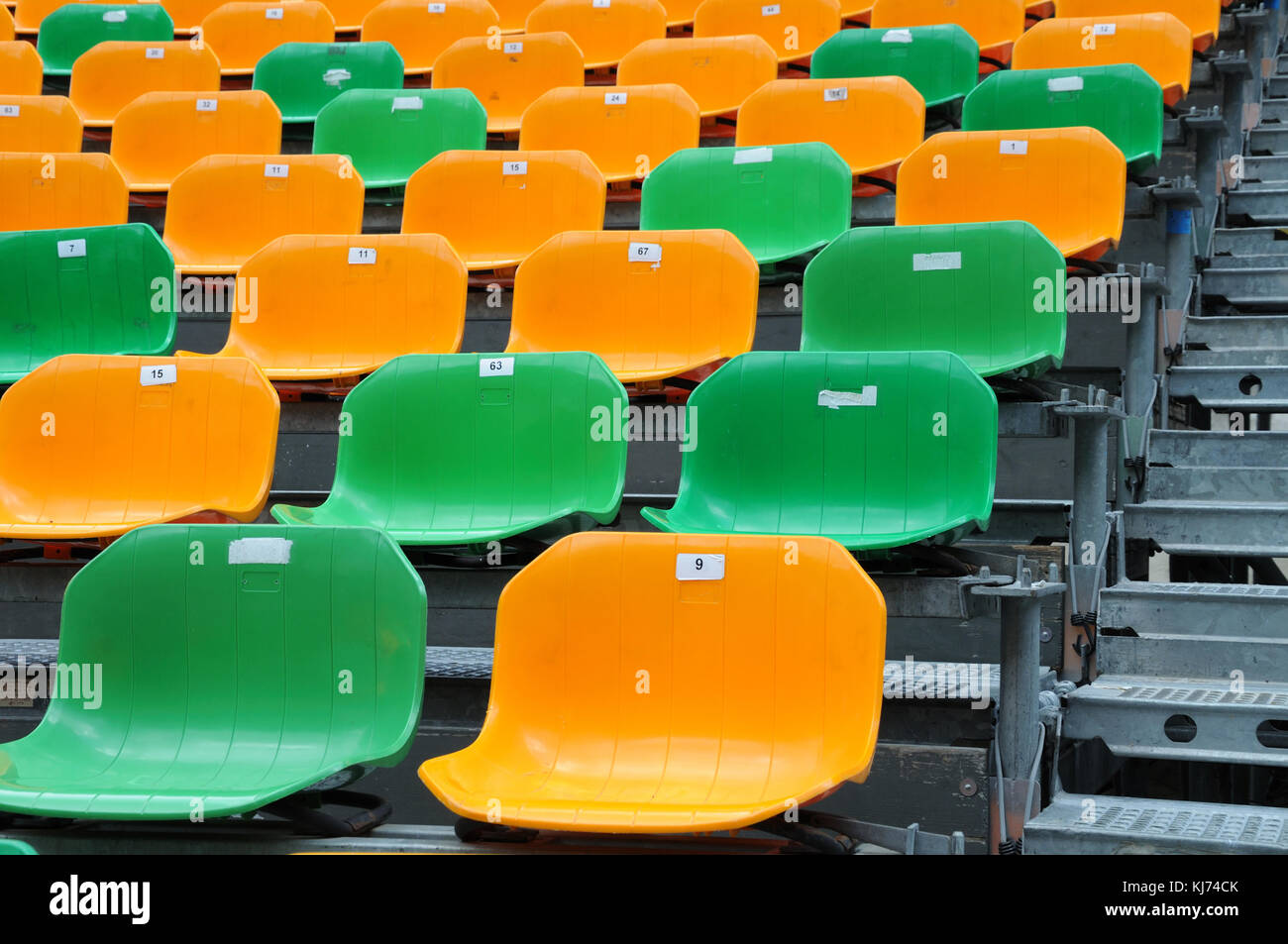 plastic chairs at a grandstand - Stock Image