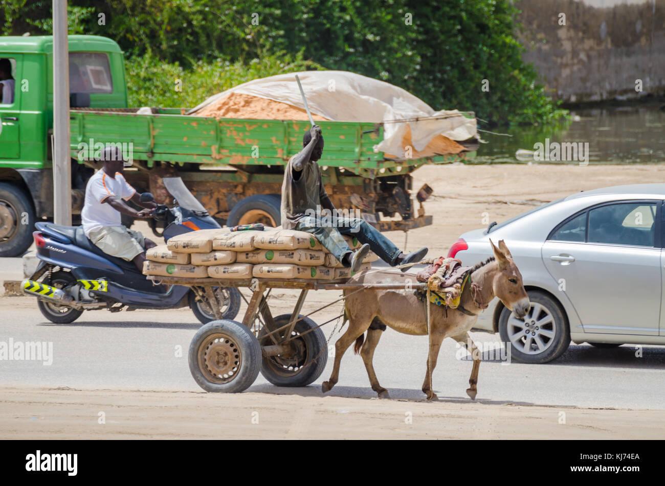 Nouakchott, Mauritania - October 08 2013: Street scene with vehicles and donkey cart - Stock Image
